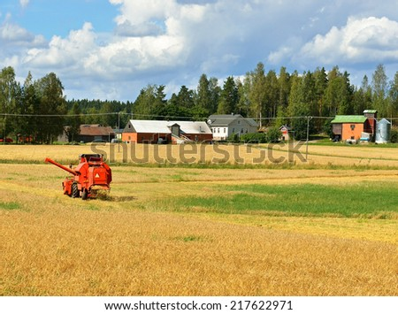 Grain Harvester Combine collecting from crops of rye - stock photo