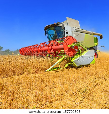 Grain harvesting combine.  - stock photo
