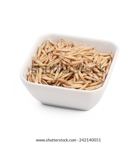 grain of oats in cup isolated - stock photo
