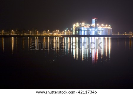 Grain port on river bank. A night view