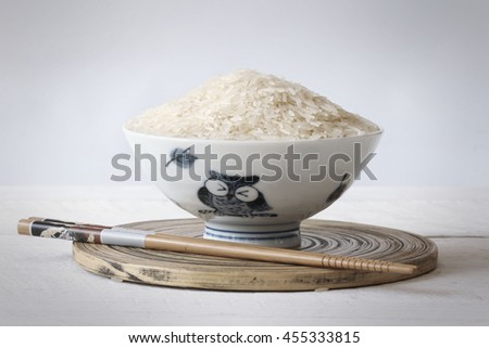 Grain rice bowl with chopsticks on a wooden table. - stock photo