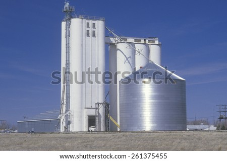 Grain silo co-op in KS with a blue sky in the background