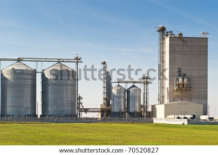 grain silos for agriculture on blue sky - stock photo