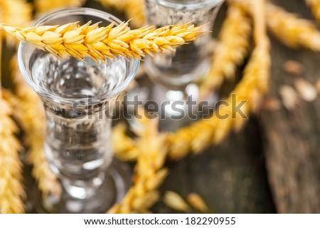Grain, with grain liquor on wood  - stock photo