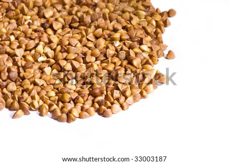 grains of  buckwheat on a white background