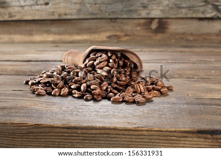 grains of coffee and wooden desk