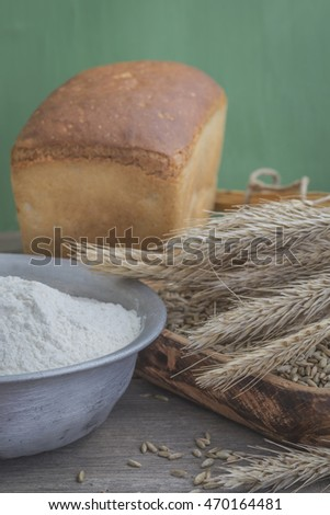 Grains of rye, flour and bread in retro style