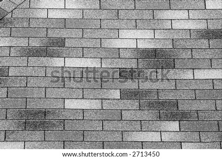 Grainy rough tiles of a gray roof