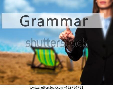 Grammar - Businesswoman hand pressing button on touch screen interface. Business, technology, internet concept. Stock Photo - stock photo