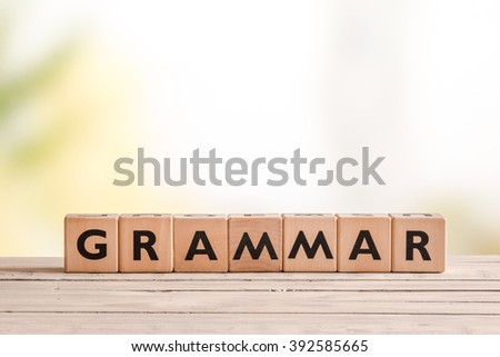 Grammar sign made of wood on a school desk - stock photo