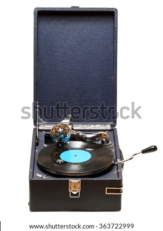 Gramophone with a vinyl record on wooden table. Isolated on white background - stock photo
