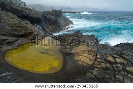 Gran Canaria, north west coast at Banaderos area, basalt rocks and seawater pools - stock photo