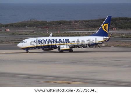 GRAN CANARIA, SPAIN - DECEMBER 7, 2015: Ryanair Boeing 737 taxis at Las Palmas Airport in Gran Canaria, Spain. Ryanair had 81.7 million passengers in 2014. - stock photo