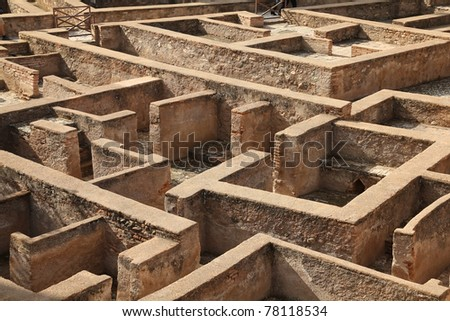 Granada in Andalusia region of Spain. Alhambra castle, Nasrid palace. UNESCO World Heritage Site. Building remains looking like a maze. - stock photo