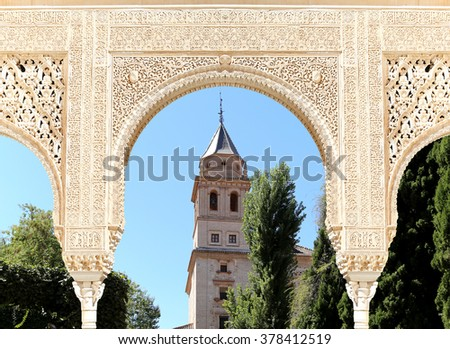GRANADA, SPAIN- AUGUST 26, 2014: Arches in Islamic (Moorish)  style and  Alhambra, Granada, Spain - stock photo