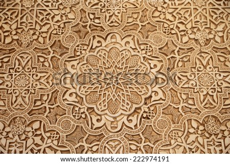 GRANADA, SPAIN- AUGUST 26, 2014:Detail of Islamic (Moorish) tilework at the Alhambra, Granada, Spain. Great background texture  - stock photo