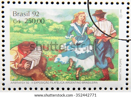 GRANADA, SPAIN - DECEMBER 1, 2015: stamp printed in Brazil dedicated to gaucho costume, dance shows, 1992 - stock photo