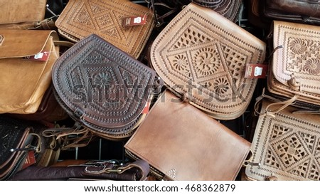 Granada, Spain - June 21, 2016: Leather handbags for sale on the Spanish market