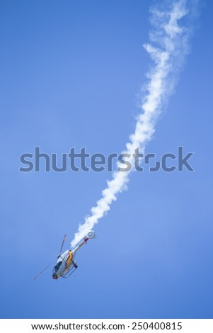 GRANADA,SPAIN - May 18: Aerobatic Spanish helicopter patrol (ASPA Patrol) perform at airshow (10�º Anniversary of Aspa Patrol in Granada) on May 18, 2014 in Granada ,Spain