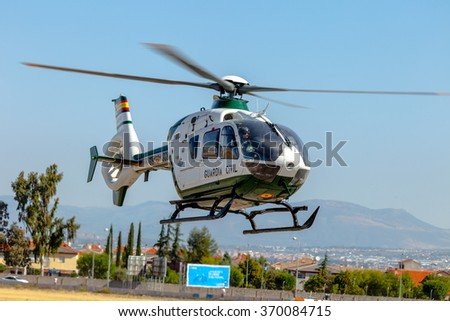 GRANADA, SPAIN-MAY 18:  Helicopter Eurocopter EC135 taking part in a  exhibition on the X aniversary of the Patrulla Aspa of the airbase of Armilla on May 18, 2014, in Granada, Spain - stock photo