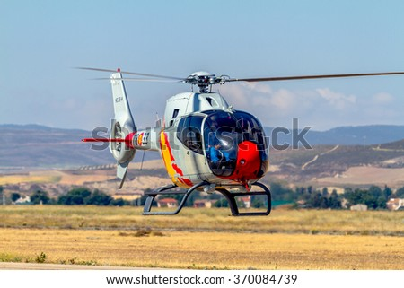 GRANADA, SPAIN-MAY 18: Helicopters of the Patrulla Aspa taking part in a exhibition on the X Aniversary of the Patrulla Aspa of the airbase of Armilla on May 18, 2014, in Granada, Spain - stock photo