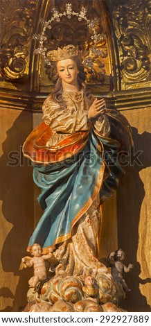 GRANADA, SPAIN - MAY 29, 2015: The carved and polychrome baroque statue of Immaculate Conception in church iglesia San Hipolito by Teodosio Sanchez Canada and Martin Lopez (1735). - stock photo