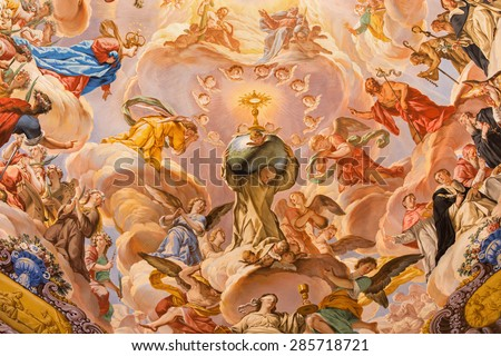GRANADA, SPAIN - MAY 31, 2015: The detail of fresco in baroque sanctuary (Sancta Sanctorum) in church Monasterio de la Cartuja with St. Bruno and glory of Eucharist by Palomino (early of 18. cent.) - stock photo