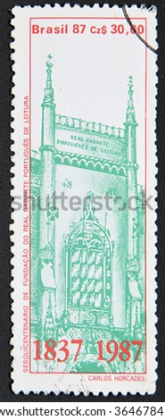GRANADA, SPAIN  - NOVEMBER 30, 2015: A stamp printed in Brazil shows Portuguese gate, Royal Portuguese Reading Cabinet, 1987