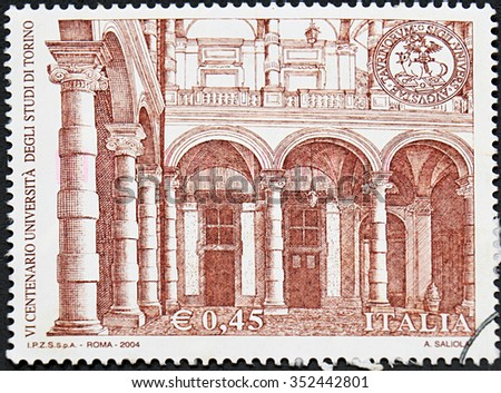 GRANADA, SPAIN - NOVEMBER 30, 2015: A stamp printed in Italy shows University of Turin, 600th Anniv., 2004 - stock photo