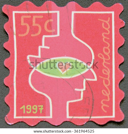 GRANADA, SPAIN - NOVEMBER 30, 2015:  A stamp printed in Netherlands shows two profiles and heart, 1997 - stock photo