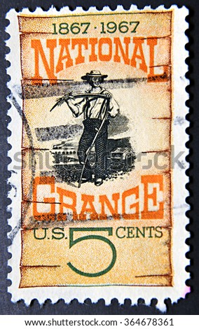 GRANADA, SPAIN - NOVEMBER 15, 2015: A stamp shows Grange Poster, 1870, Centenary the founding of the National Grange, American farmers organization, 1967