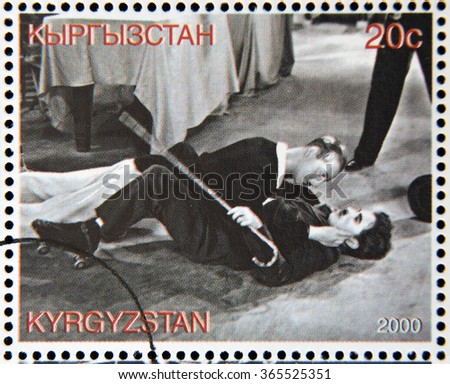 "GRANADA, SPAIN - OCTOBER 19, 2015: A stamp printed in Kyrgyzstan shows scene from the movie ""Modern Times"" by Charles Chaplin, circa 2000 - stock photo"
