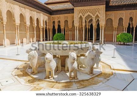 GRANADA, SPAIN - SEPTEMBER 9: Patio de los leones in Alhambra of Granada on September 9, 2015 in Granada, Spain. Alhambra of Granada is one of the most known monuments in Spain. - stock photo