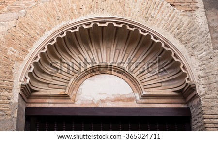 GRANADA, SPAIN - SEPTEMBER 8 2015: Tympanum in the shape of a shell at the former Franciscan Convent in The Alhambra complex, on September 8, 2015, in Granada, Spain - stock photo