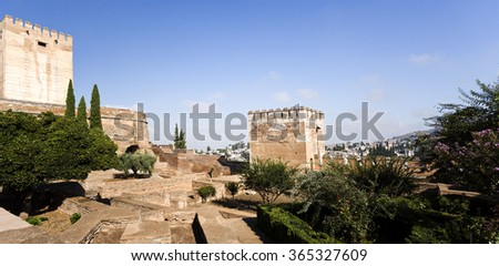 GRANADA, SPAIN - SEPTEMBER 8 2015: View of the Homage (left) and Hens (right) Towers in The Alhambra, on September 8, 2015, in Granada, Spain - stock photo