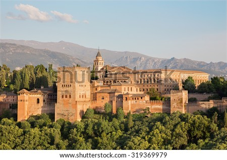 Granada - The Alhambra palace and fortness complex in evening light. - stock photo