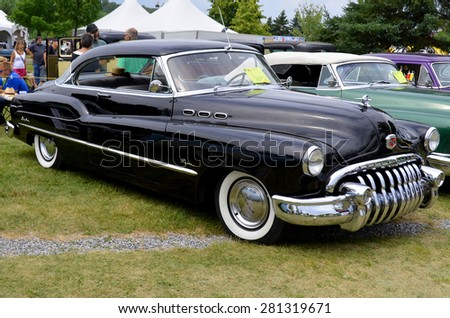 GRANBY QUEBEC CANADA JULY 29 2013: Buick Riviera 1950. The 1950 Supers shared with all the other series totally new all bumper guard grille and more rounded styling.  - stock photo