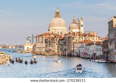 Grand Canal and Basilica of Santa Maria della Salute at sunset in Venice, Italy. - stock photo