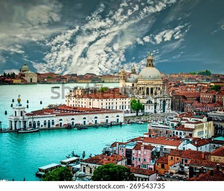 Grand Canal and Basilica Santa Maria della Salute against blue sky, Venice, Italy - stock photo