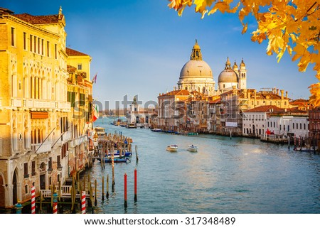 Grand Canal and Basilica Santa Maria della Salute illuminated by evening sun