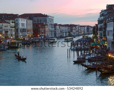 Grand Canal and gondola silhouette at evening in Venice, Italy. - stock photo
