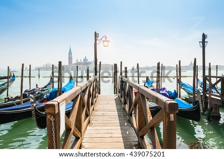Grand canal and gondolas moored near San Marco square in Venice, Italy - stock photo