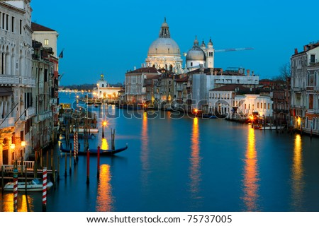 Grand canal and The Basilica of St Mary of Health (Basilica di Santa Maria della Salute) in Venice. - stock photo