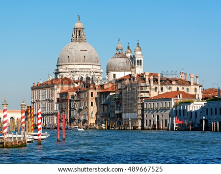 Grand canal in Venice with old houses and the church Santa Maria della Salute in the background