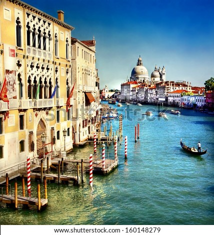 Grand Canal of Venice with the famous landmark cathedral Santa Maria della Salute at the background  - stock photo