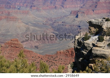 Grand Canyon, Arizona, south rim view into canyon with cliffs in foreground - stock photo