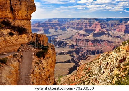 Grand canyon day view with the trail - stock photo
