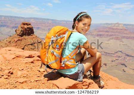Grand Canyon hiker woman resting portrait. Hiking multiethnic girl relaxing on South Kaibab Trail, south rim of Grand Canyon, Arizona, USA. - stock photo