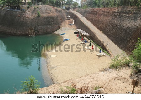 Grand canyon in ChiangMai, Thailand. Reservoir from old soil mine. - stock photo
