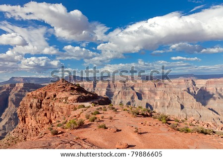 Grand canyon in sunny day with blue sky and clouds - stock photo